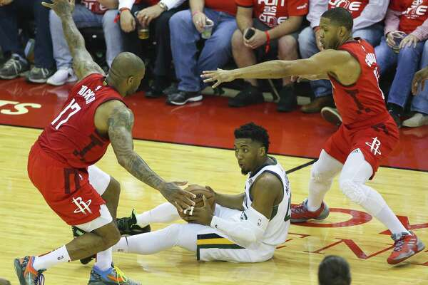 Houston Rockets forward PJ Tucker (17) and guard Eric Gordon (10) defend Utah Jazz guard Donovan Mitchell (45) during Game 5 of an NBA first round playoff series at Toyota Center in Houston, Wednesday, April 24, 2019.