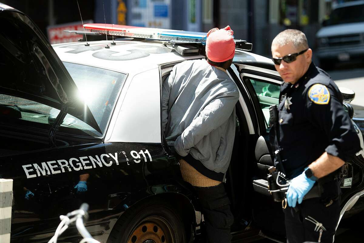 A police officer from SFPD's Tenderloin station make an arrest, not drug-related, on Eddy St. on Thursday, April 25, 2019, in San Francisco.