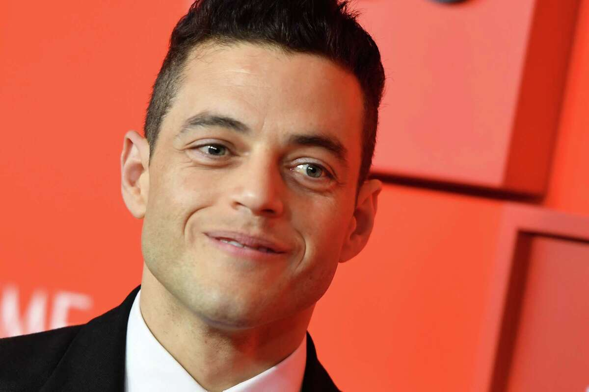 """(FILES) In this file photo taken on April 23, 2019 US actor Rami Malek arrives on the red carpet for the Time 100 Gala at the Lincoln Center in New York. - Oscar winner Rami Malek hinted on April 25, 2019 that he would appear in the role of a villain in the latest James Bond film starring Daniel Craig, alongside a cast including Ralph Fiennes and Lea Seydoux. Malek, who won the Oscar for his performance as Freddie Mercury in """"Bohemian Rhapsody"""", said in a video message: """"I promise you all I will be making sure Mr Bond does not have an easy ride in this"""". (Photo by ANGELA WEISS / AFP)ANGELA WEISS/AFP/Getty Images"""