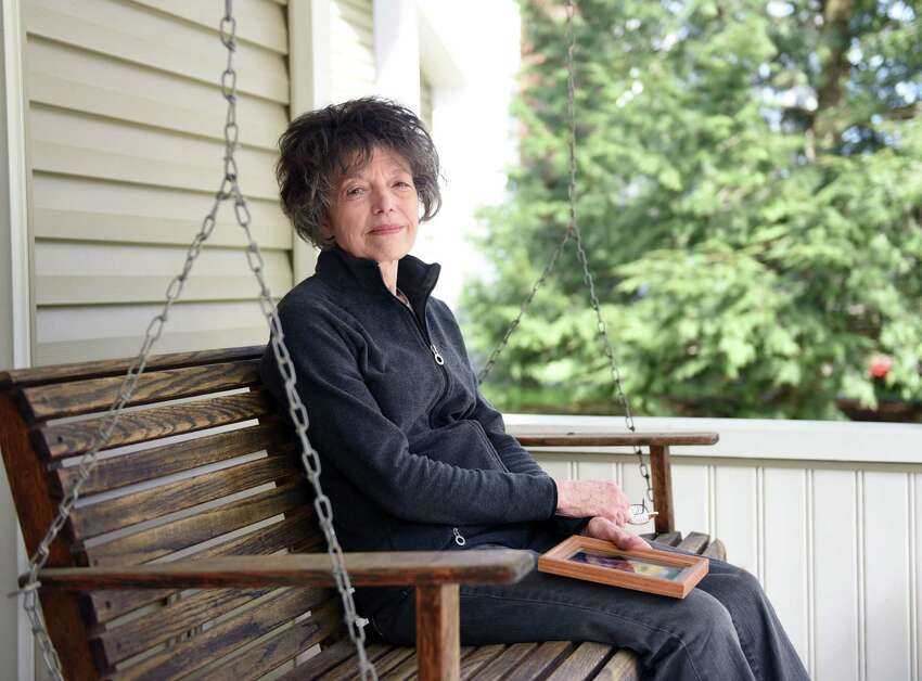 Karen Pass sits on her porch for a portrait on Thursday, April 25, 2019 at her home in Glenmont, NY. Her husband, Kenneth Pass, had ALS, a neurodegenerative disease that causes you to lose the ability to speak, eat, move and eventually breathe, died in 2015. (Phoebe Sheehan/Times Union)