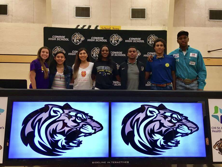 Conroe athletes (from left) Jazmin Torres, Biririana Hernandez, Zarelia Coria, Jamaya Williams, Misael Martinez, Jayshawn Foots and Jamarcus Horace signed their national letters of intent on Thursday. Photo: Rob Tate / Staff Photographer