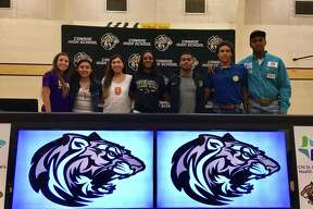 Conroe athletes (from left) Jazmin Torres, Biririana Hernandez, Zarelia Coria, Jamaya Williams, Misael Martinez, Jayshawn Foots and Jamarcus Horace signed their national letters of intent on Thursday.