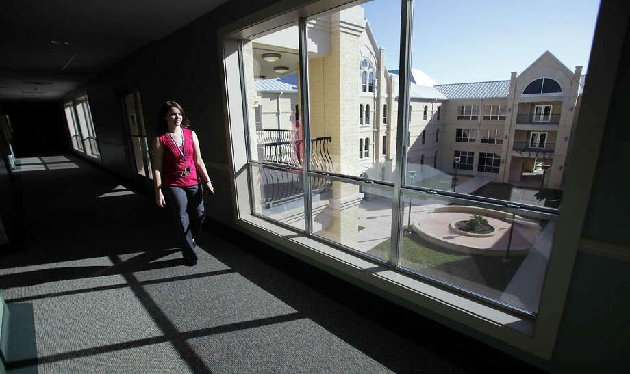 Charity Bowen, Hall Director at Founders Hall at St. Mary's University, walks down a hall in the new freshman dorm in 2011. At St. Mary's the Aspirational Strategic Action Plan reshapes the education that undergraduate, graduate and certificate students receive in the arts, humanities and social sciences. Photo: BOB OWEN /SAN ANTONIO EXPRESS-NEWS / rowen@express-news.net