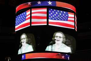 """Singer Kate Smith is seen on the screen before Game Six of the 2010 NHL Stanley Cup Final between the Chicago Blackhawks and the Philadelphia Flyers at the Wachovia Center on June 9, 2010 in Philadelphia, Pa. The Flyers have covered the Smith statue outside Xfinity Live! and will no longer play her recording of """"God Bless America."""""""