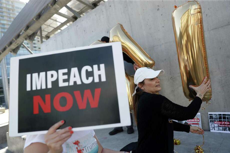Frankie Wallace assembles a balloon display during an Impeach Donald Trump rally at 7th and Mission Streets outside of House Speaker Nancy Pelosi's office in San Francisco, on Monday. Democrats would be sorely disappointed after impeachment. Photo: Scott Strazzante /The Chronicle / San Francisco Chronicle