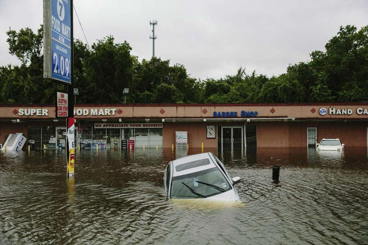 A flooded car along Kuykendahl Road after Hurricane Harvey swept through through Houston, Aug. 29, 2017.