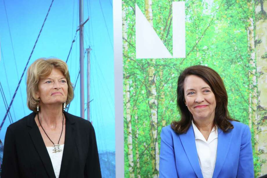 U.S. Senators Maria Cantwell (D-WA), right, and Lisa Murkowski (R-AK) participate in a ceremony revealing the Nordic Museum's new designation as the National Nordic Museum, Thursday, April 25, 2019.  The Senators worked together on a bipartisan public lands package that promoted the museum to its new status. Photo: Genna Martin, Seattlepi.com / GENNA MARTIN