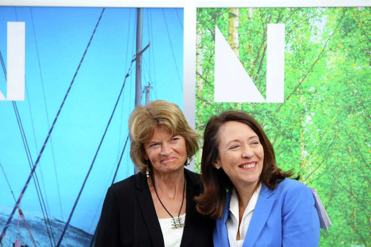 U.S. Senators Maria Cantwell (D-WA), right, and Lisa Murkowski (R-AK) participate in a ceremony revealing the Nordic Museum's new designation as the National Nordic Museum, Thursday, April 25, 2019. The Senators worked together on a bipartisan public lands package that promoted the museum to its new status.