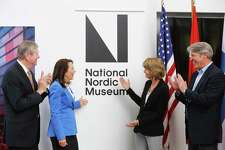 From left, board president Tom Malone, U.S. Senator Maria Cantwell (D-WA), U.S. Senator Lisa Murkowski (R-AK) and museum CEO Eric Nelson participate in a ceremony revealing the Nordic Museum's new designation as the National Nordic Museum, Thursday, April 25, 2019. The Senators worked together on a bipartisan public lands package that promoted the museum to its new status.