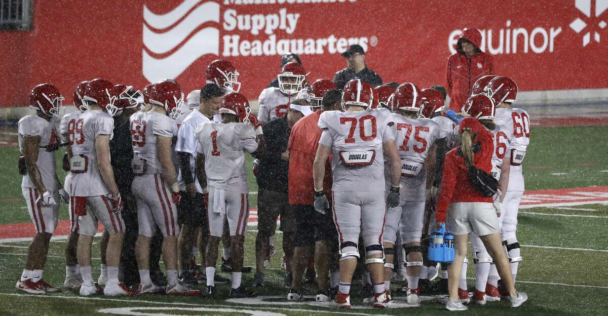 PHOTOS: Friday Night Lights The Houston Cougars offense huddles as the rain drenched them during the University of Houston's Friday night lights spring football practice, Friday, April 12, 2019, in Houston. Browse through the photos to see action from UH's spring practice.