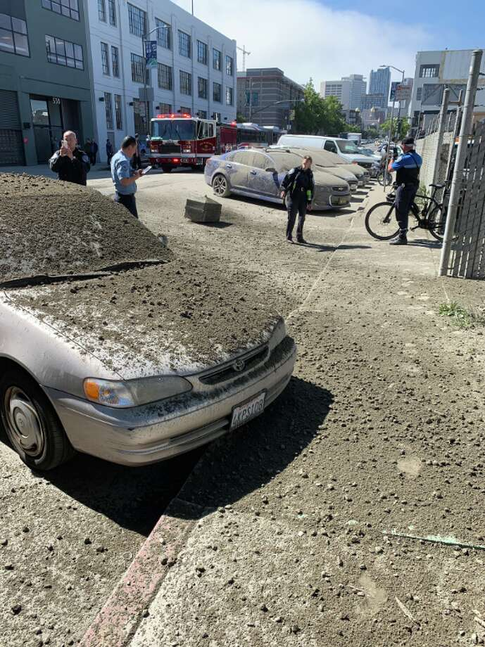 Cars parked in the area of 10th and Bryant were covered in gravel after a cement truck overturned on the elevated portion of Highway 101. Photo: @PartridgeThad / Twitter