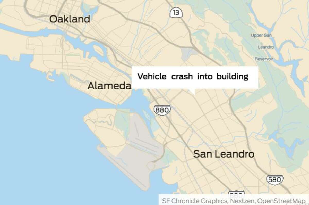 A motorist was arrested Thursday after crashingavehicle into a building on the same street as New Highland Academy in Oakland, authorities said.
