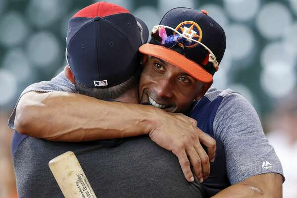 HOUSTON, TX - APRIL 25: Houston Astros left fielder Michael Brantley #23 greets Cleveland Indians second baseman Jason Kipnis #22 before the game at Minute Maid Park on April 25, 2019 in Houston, Texas. (Photo by Tim Warner/Getty Images)