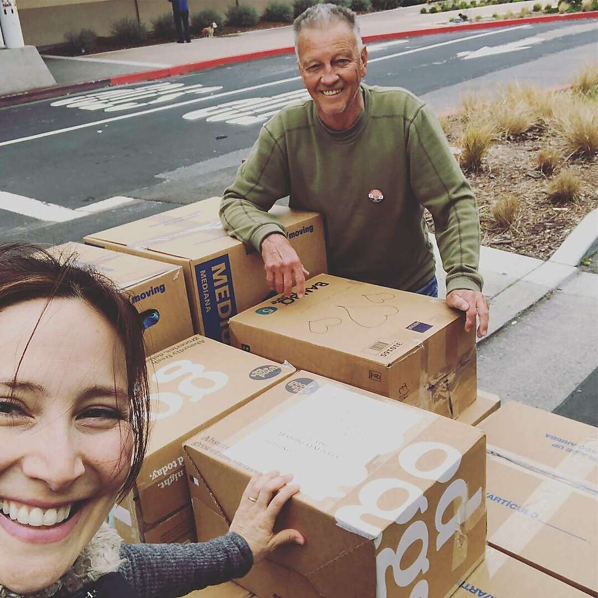 Eliana Lopez and boxes packed for Venezuela
