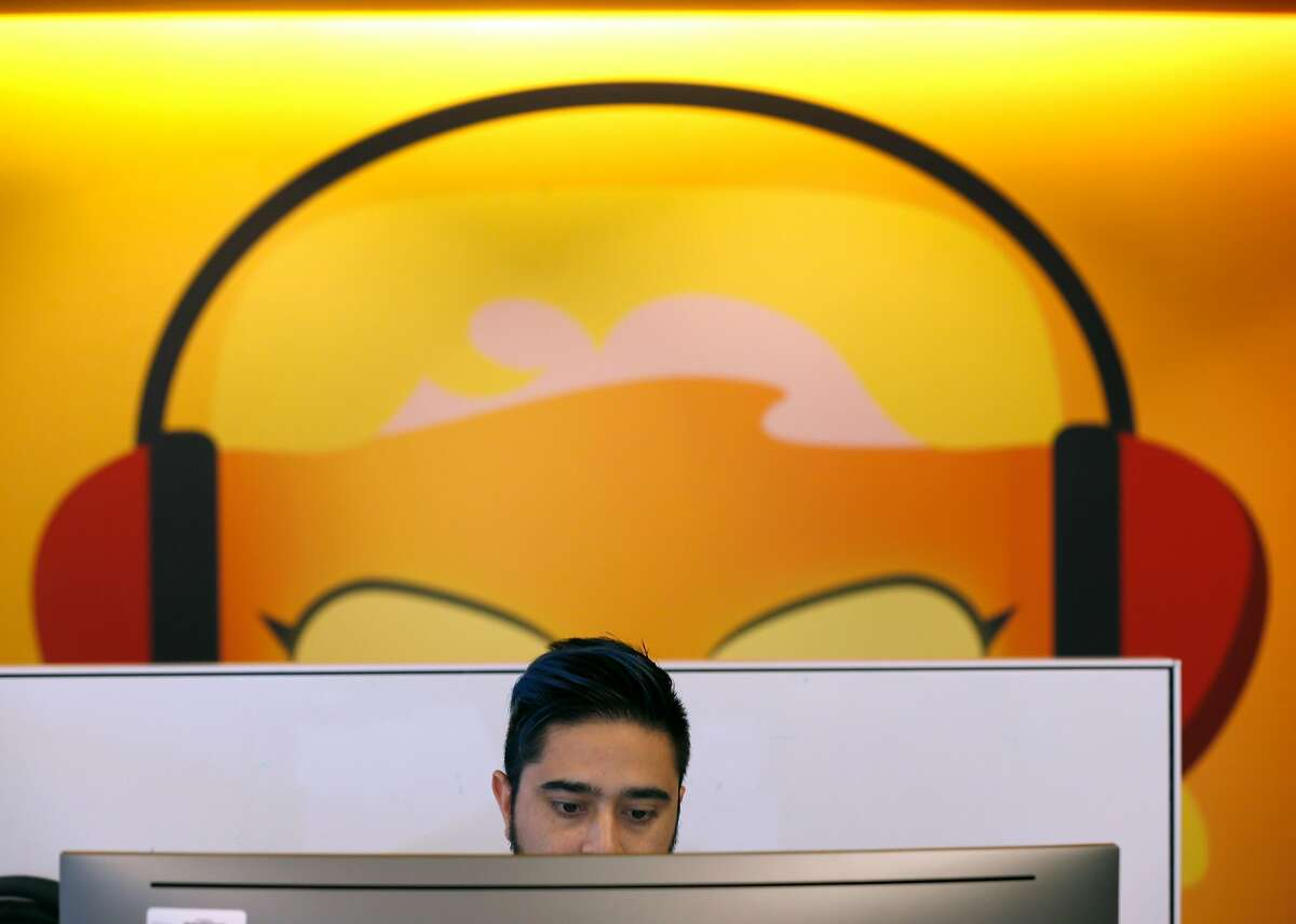Sameem Siddiqui works at his desk in the offices for Amazon Music and AWS in San Francisco, Calif. on Thursday, April 25, 2019.