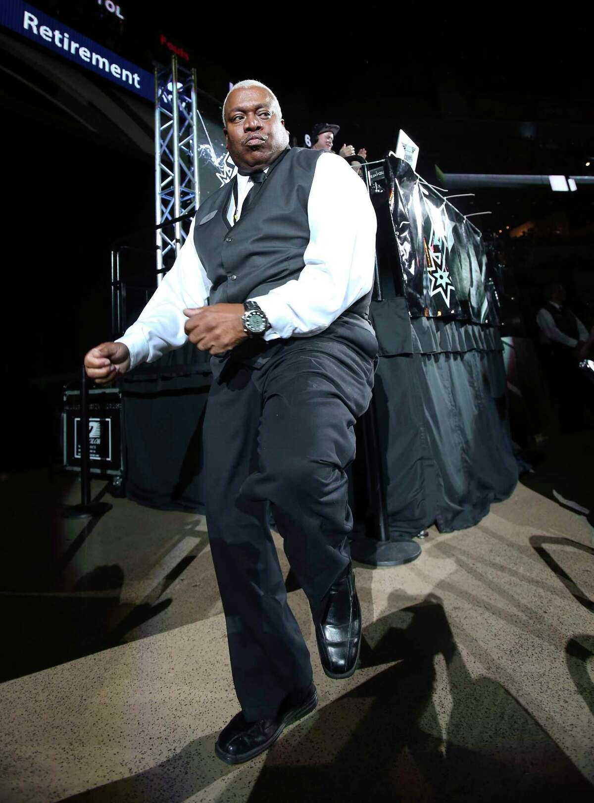 Like most NBA teams, the Spurs are playing in emptied arenas, but they aren't entirely without fans when the AT&T Center employees are ushering in the excitement. (Eric Byrd dancing at a game in December 2014)