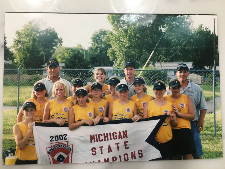 Members of the 2002 Southtown Little League Softball major state championship team pose with their title banner after upsetting West Portage in the final. Members of the team are (front, from left) Rachel Church, Jessica Chatterton, Sara Bober, Sarah Schwedler, Jennifer Chatterton, Sarah Klingler; (middle, from left) Angela Bradshaw, Becca Burch, Allison Hagle, Clara Juengel, Heather Collamer-Rowe; and (back, from left) coach Brian Burch, Renae Lange, manager Mark Juengel, and coach Joe Lange. Photo: Photo Provided