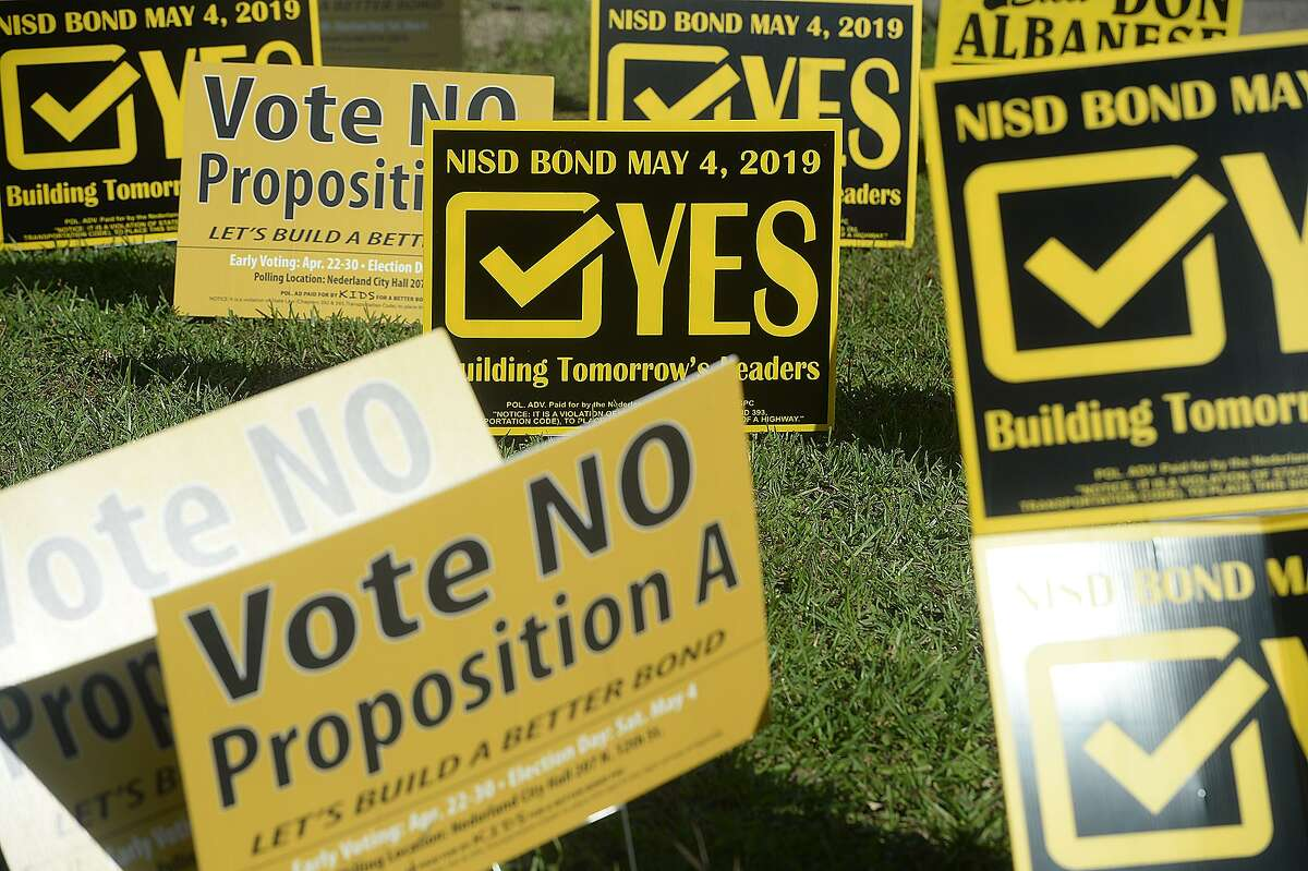 Election signs fill the grassy area across from City Hall in Nederland, which is the polling site for early voters. The majority are urging yes and no votes to the NISD bond proposal. Photo taken Thursday, April 25, 2019 Kim Brent/The Enterprise