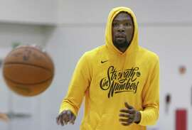 Assistant coach Bruce Fraser passes to Kevin Durant at a Golden State Warriors practice session in Oakland, Calif. on Tuesday, April 23, 2019 before Game 5 of the first round against the Los Angeles Clippers Wednesday night.