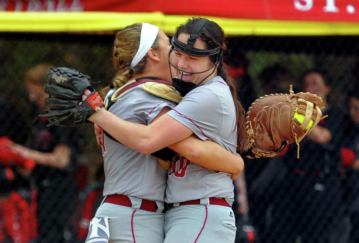 St. Joseph catcher Charlie Horton (11), left, and pitcher pitcher Payton Doiron (10) hug each other after beating Cheshire during softball action in Trumbull, Conn., on Wednesday April 25, 2019.