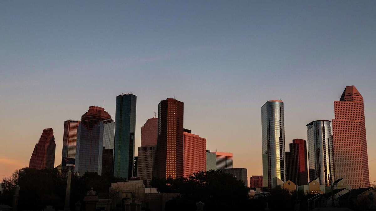 """The downtown Houston skyline, January 20, 2019, hours before a """"Super Wolf Blood Moon"""" lunar eclipse. View is from Wilson St., south of West Dallas Ave. with Beth Israel Cemetery in the foreground."""