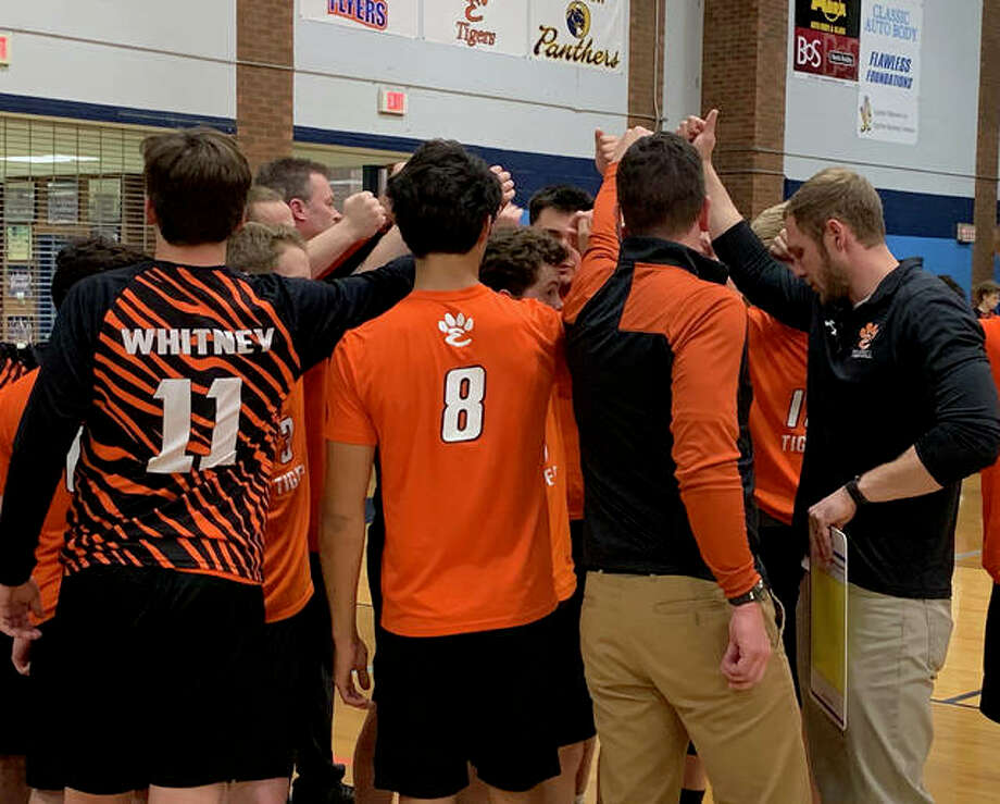 Edwardsville gathers during a timeout in the first game against Belleville East. Photo: Matt Kamp/The Intelligencer