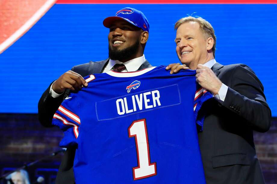 PHOTOS: Players from Houston high schools and Texas college drafted in 2019  NASHVILLE, TENNESSEE - APRIL 25: Ed Oliver of Houston poses with NFL Commissioner Roger Goodell after being chosen #9 overall by the Buffalo Bills during the first round of the 2019 NFL Draft on April 25, 2019 in Nashville, Tennessee. (Photo by Andy Lyons/Getty Images) >>>A look at players who were taken in the 2019 NFL Draft that went to Houston high schools or Texas colleges ...  Photo: Andy Lyons/Getty Images