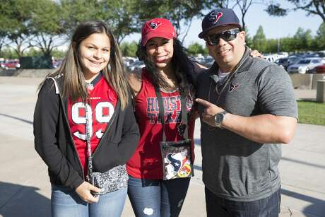 Houston Texans fans pose for a photograph at the 2019 Houston Texans Draft Party at NRG Stadium on Thursday, April 25, 2019, in Houston.