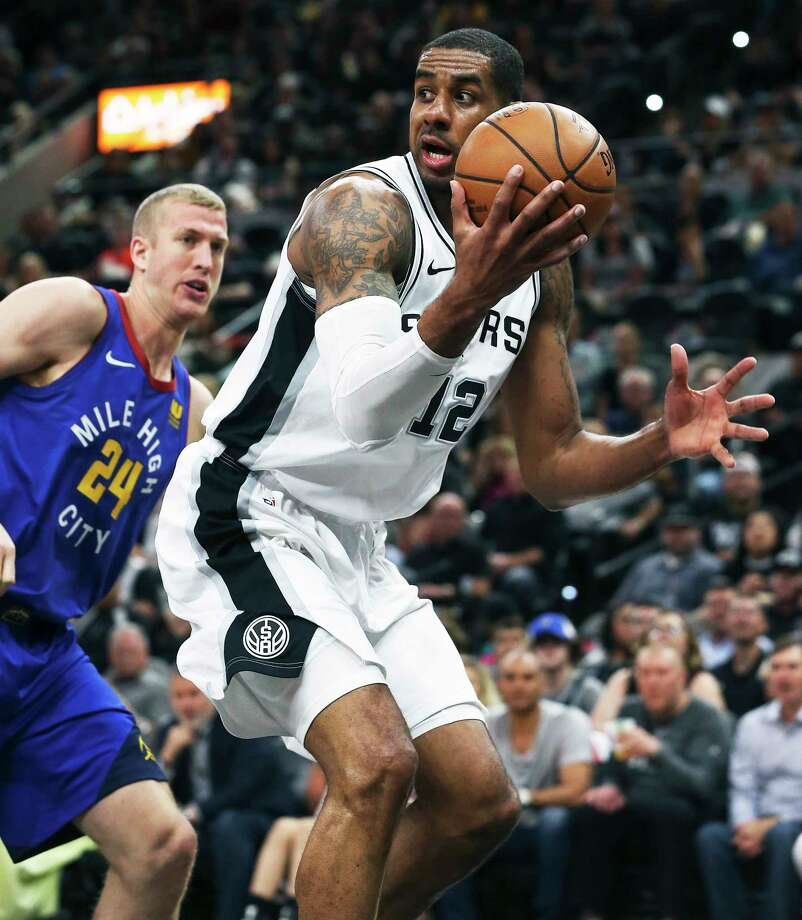 LaMarcus Aldridge saves a loose ball undet the rim and looks for an open teammate as the Spurs host the Nuggets in game 6 of the first round of the Western Conference playoffs at the Alamodome on April 25, 2019. Photo: Tom Reel, Staff Photographer / 2019 SAN ANTONIO EXPRESS-NEWS