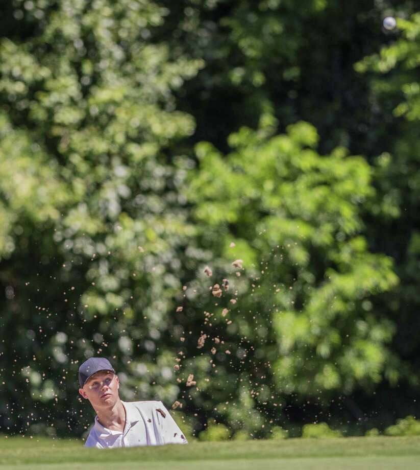 Clark's Garrett Endicott hits one out of the bunker at No. 12, par 4 during the second round of the Region IV-6A golf tournament at the Republic Golf Club on Thursday, Apr. 25, 2019. Photo: /Carlos Javier Sanchez / Contributor / Carlos Javier Sanchez