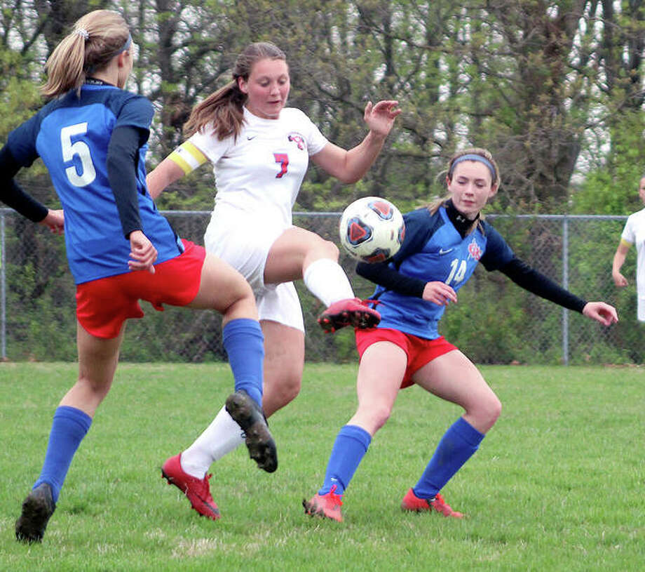 Roxana's Kortni Laws (7) tries to control the ball between Carlinville's Adrienne Welte (5) and Rory Drew 914) during Thursday's South Central Conference game in Carlinville. The Cavies won 3-1. Photo: Pete Hayes | The Telegraph