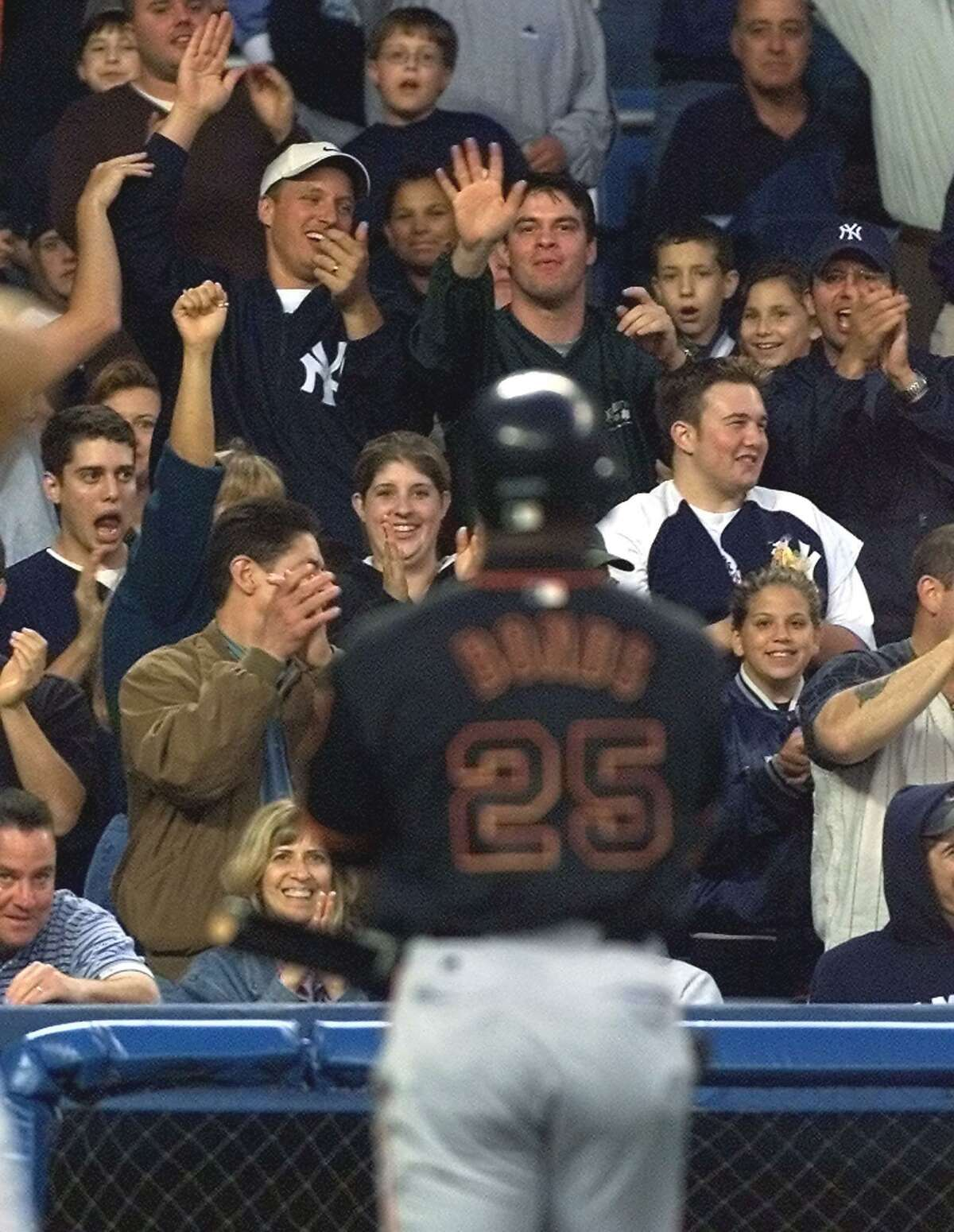 New York Yankee fans heckle San Francisco Giants' left fielder Barry Bonds as he walks back to the dugout after striking out in the third inning 07 June 2002 at Yankee Stadium in the Bronx, NY.