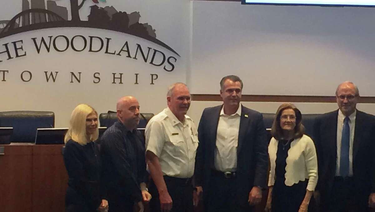 The Woodlands Fire Department Fire Chief Alan Benson, in white, poses with members of The Woodlands Township Board of Directors and township President and General Manager Don Norrell on Wednesday, April 24, after it was announced he was retiring effective May 2, 2019.