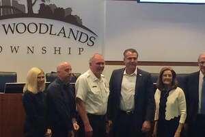 The Woodlands Fire Department Fire Chief Alan Benson, in white, poses with members of The Woodlands Township Board of Directors and township President and General Manager Don Norrell on Wednesday, April 24, after it was announced he was retiring effective May 2. The application period for candidates seeking to replace Benson closed in June 14 and township human resources officials are now vetting the applicants before setting up the first round of interviews.