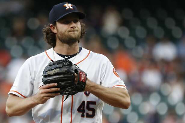 Houston Astros starting pitcher Gerrit Cole (45) reacts during the first inning of an MLB baseball game at Minute Maid Park, in Houston, Thursday, April 25, 2019.