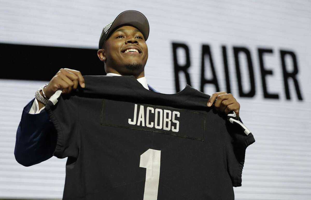 Alabama running back Josh Jacobs poses withhis new jersey after the Oakland Raiders selected Jacobs in the first round at the NFL football draft, Thursday, April 25, 2019, in Nashville, Tenn.(AP Photo/Mark Humphrey)