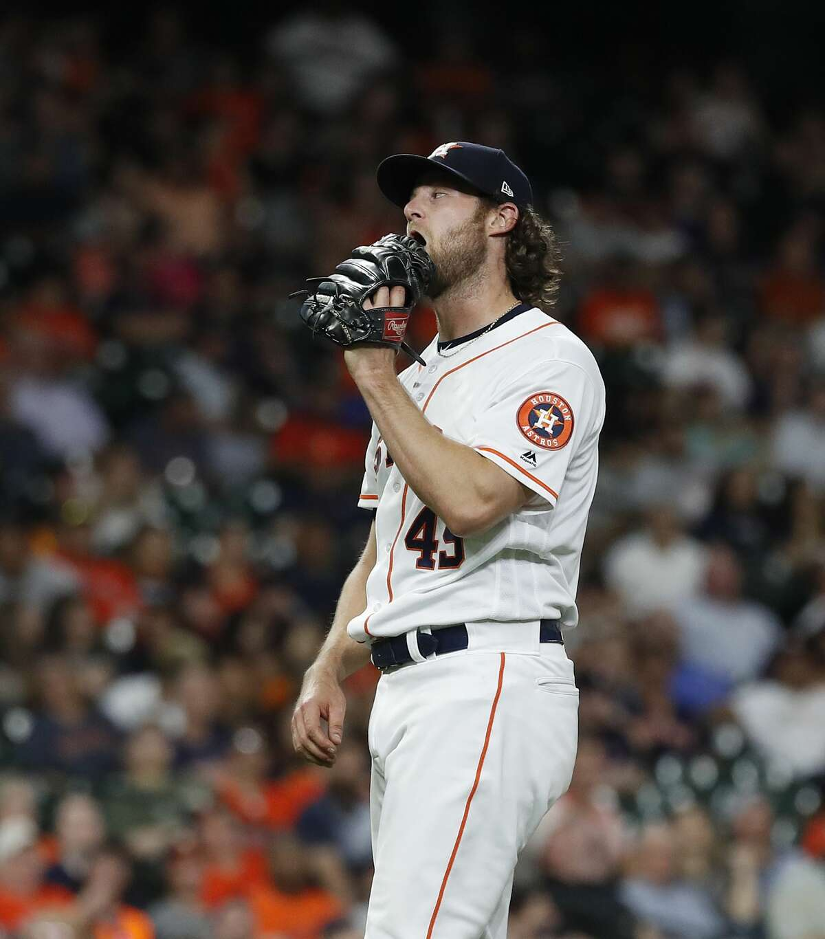 Houston Astros starting pitcher Gerrit Cole (45) reacts as he pitched against Cleveland Indians Roberto Perez during the seventh inning of an MLB baseball game at Minute Maid Park, in Houston, Thursday, April 25, 2019.
