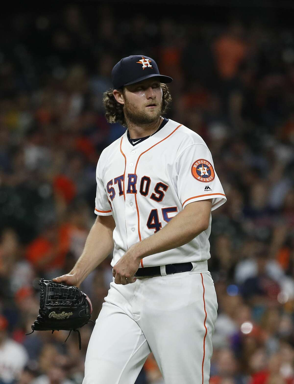 Houston Astros starting pitcher Gerrit Cole (45) reacts as he walked back to the dugout after the seventh inning of an MLB baseball game at Minute Maid Park, in Houston, Thursday, April 25, 2019.