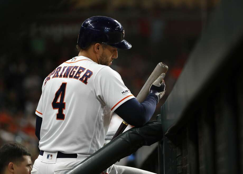 Houston Astros designated hitter George Springer (4) looks at his bat in the dugout during the seventh inning of an MLB baseball game at Minute Maid Park, in Houston, Thursday, April 25, 2019. Photo: Karen Warren/Staff Photographer