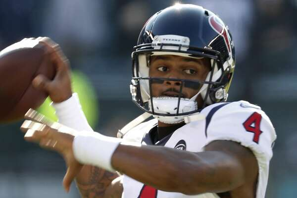 Houston Texans quarterback Deshaun Watson (4) throws a a football as he warms up before an NFL football game against the Philadelphia Eagles at Lincoln Financial Field on Sunday, Dec. 23, 2018, in Philadelphia.