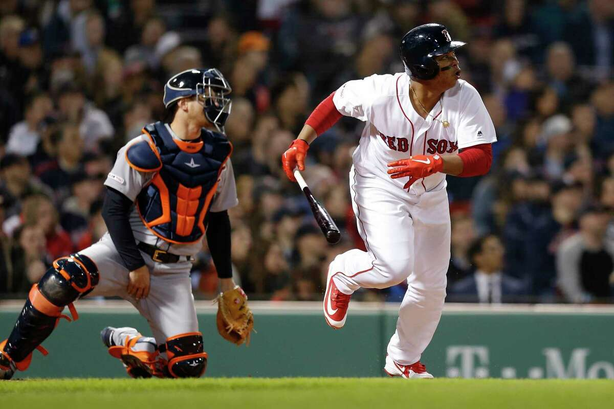 Boston Red Sox's Rafael Devers, right, watches his two-run double in front of Detroit Tigers' John Hicks during the third inning of a baseball game in Boston, Thursday, April 25, 2019. (AP Photo/Michael Dwyer)