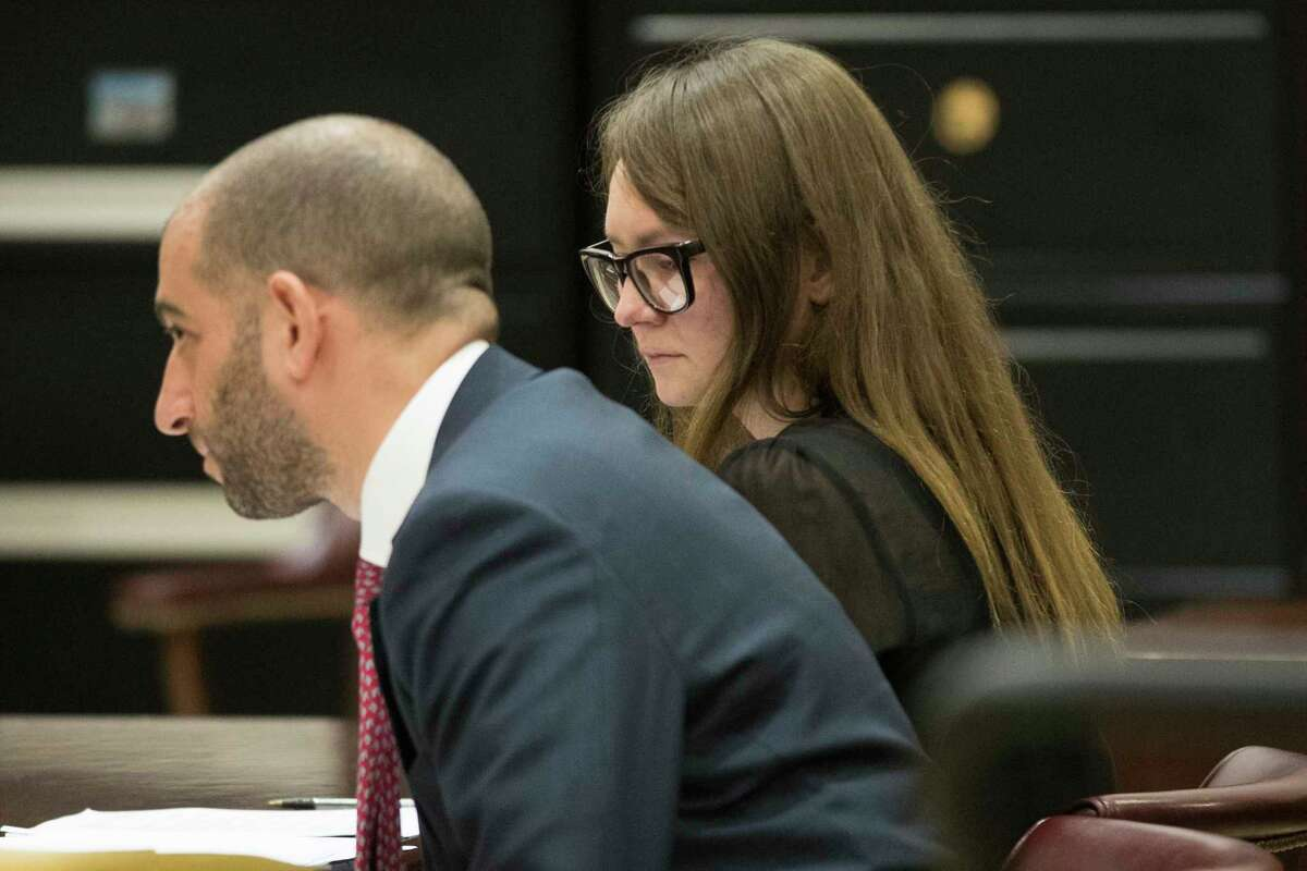 Anna Sorokin, right, and her lawyer Todd Spodek reacts as the jury foreman reads the verdict, Thursday, April 25, 2019, in New York. A Manhattan jury has convicted fake German heiress Sorokin of swindling tens of thousands of dollars from banks, hotels and friends. Jurors returned a guilty verdict Thursday following a more than three-week trial that attracted international attention. (AP Photo/Mary Altaffer)