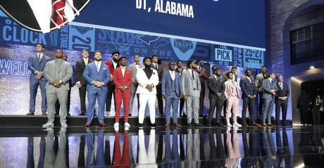 Football players are introduced ahead of the first round at the NFL football draft, Thursday, April 25, 2019, in Nashville, Tenn. (AP Photo/Mark Humphrey)