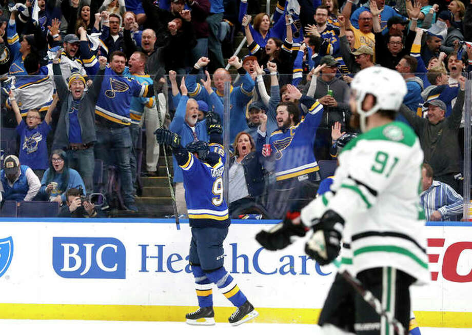 Fans and the Blues' Vladimir Tarasenko, center, celebrate a goal by Tarasenko in the second period in Game 1 the teams' second-round Stanley Cup Playoff series Thursday night in St. Louis. Photo: AP Photo