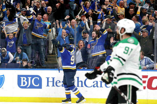 Fans and the Blues' Vladimir Tarasenko, center, celebrate a goal by Tarasenko in the second period in Game 1 the teams' second-round Stanley Cup Playoff series Thursday night in St. Louis.