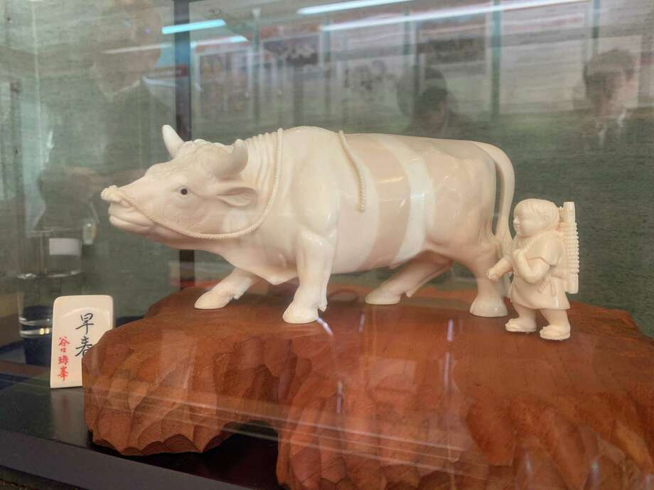 An ivory carving of a boy and a water buffalo for sale in Tokyo on April 5, 2019. Photo: Washington Post Photo By Simon Denyer. / Simon Denyer
