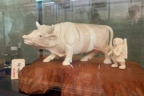 An ivory carving of a boy and a water buffalo for sale in Tokyo on April 5, 2019.