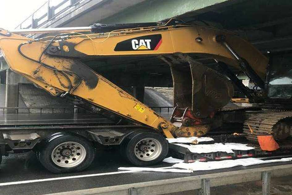 An excavator wedged underneath the Northway's bridge over Route 146 in Clifton Park is causing traffic problems on the highway and surrounding streets.