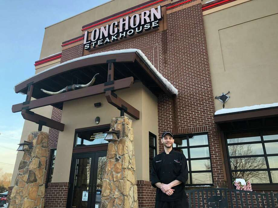 """Chris Bowman, of North Haven, was named one of LongHorn Steakhouse's top """"steak masters"""" in a regional competition. He works at the LongHorn Steakhouse on 70 Universal Dr. in North Haven. Photo: Contributed Photo"""