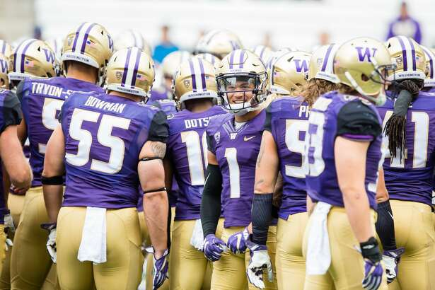 SEATTLE, WA - SEPTEMBER 09: Washington (1) Byron Murphy (DB) smiles in a huddle with teammates before a college football game between the Washington Huskies and the Montana Grizzlies on September 9, 2017 at Husky Stadium in Seattle, WA. (Photo by Christopher Mast/Icon Sportswire via Getty Images)